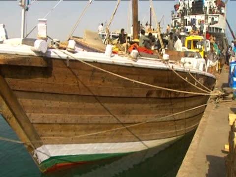 Tilt up large pirate boat captured by police Somalia 17 June 2009