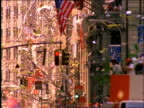 tilt up of ticker tape and paper falling from building / parade / Operation Welcome Home / NYC