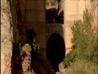 Tilt up over old stone bridge Ronda Spain