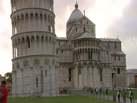 Tilt up over Pisa Cathedral and the Leaning Tower