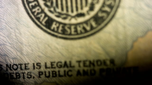 Tilt up past the United States Federal Reserve symbol on the $20 note