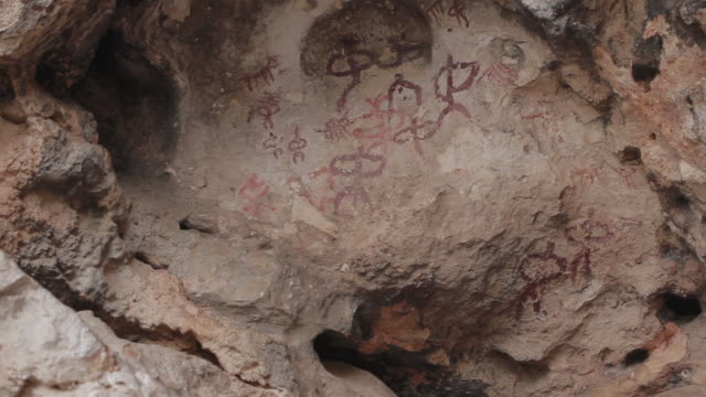W/S tilt up rock paintings of Jimena