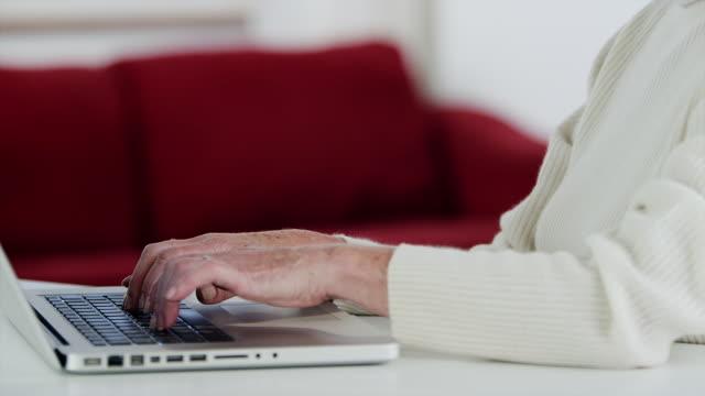 MS tilt up senior woman using laptop