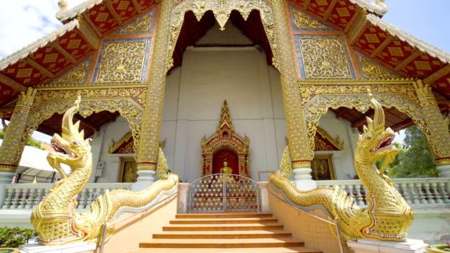 Tilt up shot 4K of Thai church, Wat Phra Singh temple, Chiang Mai - Thailand.