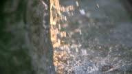 Tilt Up Shot Of Water Fountain In Garden