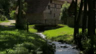 tilt up, stream and bridge infront of half timbered farm houses