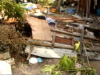 MS tilt up to damaged village caused by tsunami, Maldives