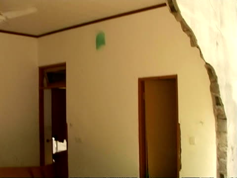 MS tilt up to section missing from wall revealing inside of room, tsunami aftermath, Maldives