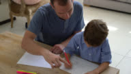 Tilt view of father and son drawing together