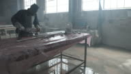 WS TILT_Man polishing marble slab, at factory