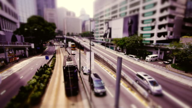 Tilt-Shift shot of Trams and Highway Traffic in Hong Kong Island