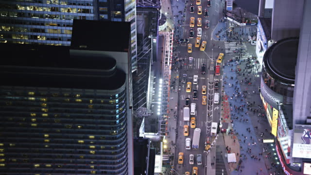 Tilt-up, flying over Times Square at night. Shot in 2011.