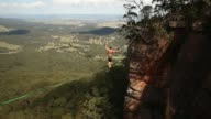 Tim Desmond of Australia falls as he walks on a highline rigged between cliffs at Corroboree Walls in Mount Victoria on March 8 2015 in the Blue...