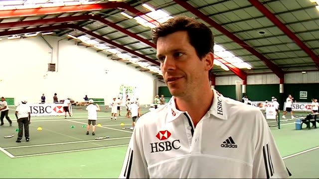 London Islington Tennis Centre INT Tim Henman interview SOT Talks about helping to get local schools to play tennis / Good to give young children...