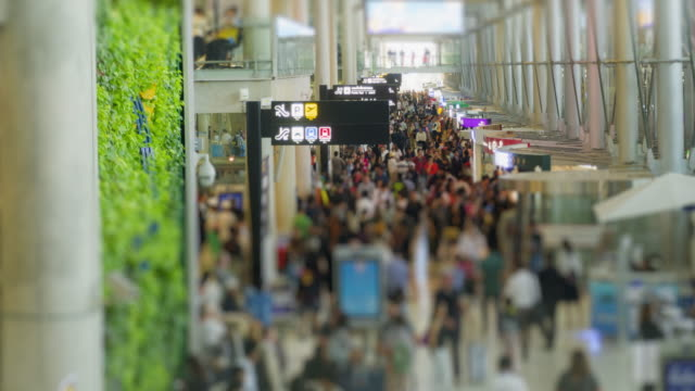 4K Time Lapse 4096x2160 : Passengers and world travelers check in at airport.