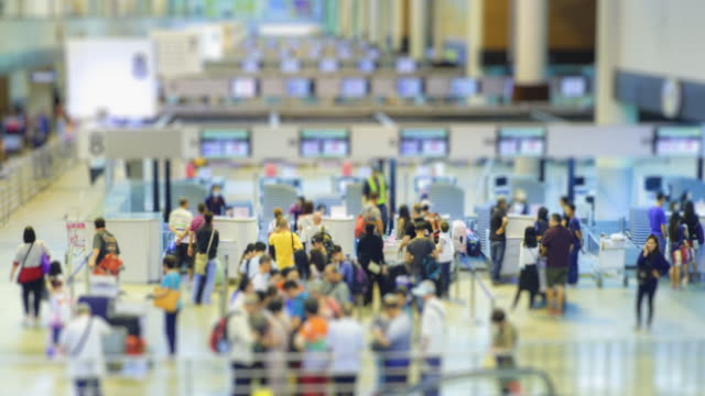 4K Time Lapse 4096x2160 : The crowd at airport passengers check in at ticket counter with ProRes 422HQ (Blur content).