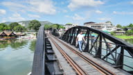 Time Lapse 4K: People Traveling on Bridge at Kwai River, Thailand