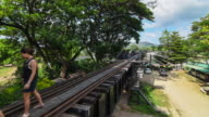 Time Lapse 4K: People Traveling on Bridge Over The River Kwai, Thailand
