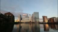 Time lapse as light changes at dawn showing clouds moving over the headquarters of Barclays Plc and HSBC Holdings Plc amongst the offices of...