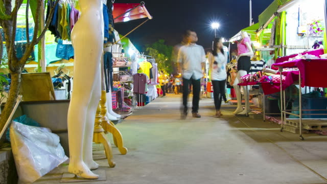 time lapse : Asian people enjoy shopping at retail market night scene