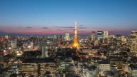 Time Lapse at Twilight time Cityscape of Tokyo Tower , Tokyo skyline kanto Japan , Dolly shot movement Right to left