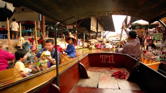 Time lapse boat point of view travelling along the Khlong Damnoen Saduak through the floating market / Bangkok, Thailand