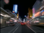 time lapse car point of view on busy city street at night / Kyoto