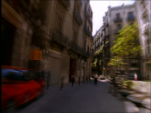 time lapse car point of view on narrow city street / Barcelona