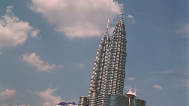 CANTED time lapse clouds behind Petrona Twin Towers skyscrapers / Kuala Lumpur, Malaysia
