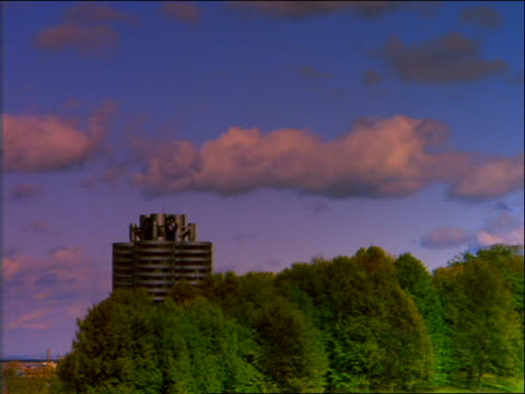 time lapse clouds over BMW office building