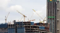 4K Time Lapse Construction : Many Crane working in Big Construction Site for industry.zoom in styles