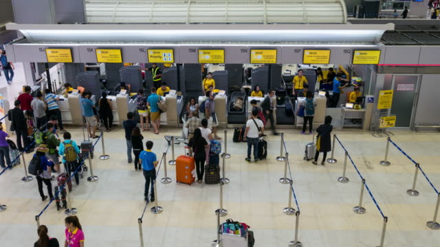 Time Lapse Crowd checking in at Airport check in counter