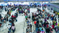 Time Lapse Crowd queueing up for check in at Airport