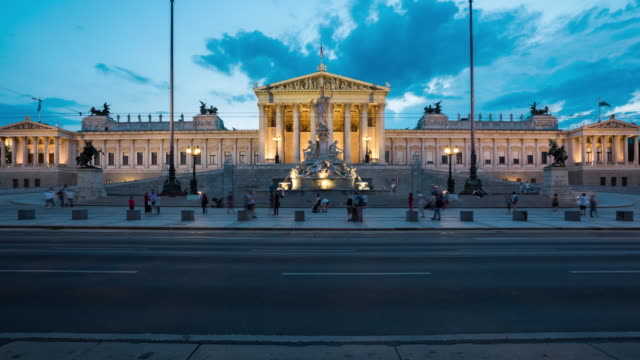 Time Lapse, Crowd waking at Austrian Parliament Building at dusk