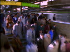 time lapse crowds getting on + off trains in subway station / Shinjuku /Tokyo