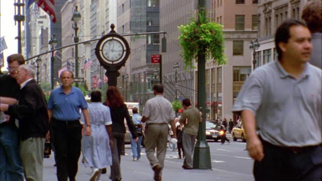 Time lapse crowds of pedestrians walking on street / Manhattan / NYC
