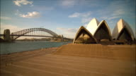 Time lapse day to night Sydney Harbour with Opera House and Harbour Bridge / Sydney, Australia