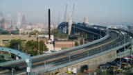 Time lapse, early morning vista with Philadelphia cityscape and traffic crossing The Ben Franklin Bridge.