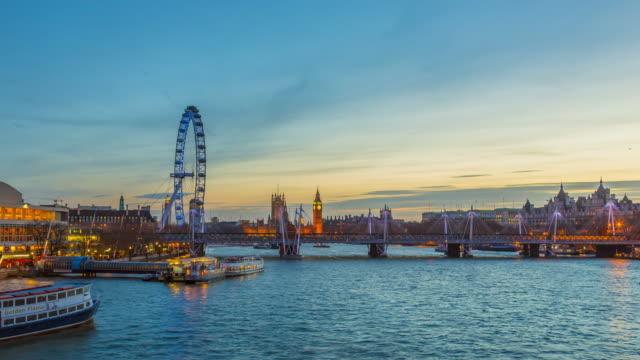 Time lapse footage of London skyline seen from Waterloo Bridge at night.