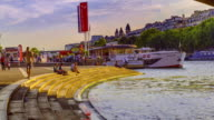 Time lapse footage of the river cruise boats activity on River Seine in Paris by the Eiffel Tower.