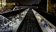 Time Lapse footage of train station from overbridge
