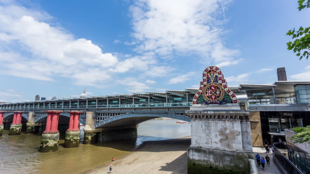 LONDON - CIRCA 2014: Time Lapse from Blackfriars bridge of Blackfriars Train Station on a sunny and cloudy day in London, England