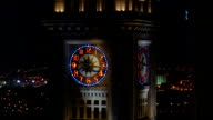 MS time lapse hands moving around clockface of Custom House Tower at night / Boston, MA