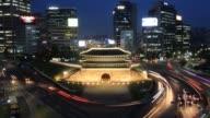 Time lapse high angle shot of Sungnyemun Gate and traffic Sungnyemun Gate In Seoul on May 24 2013 in Seoul South Korea