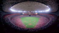 Time lapse high angle wide shot crowd sitting in stands at Houston Astrodome during baseball game / Houston