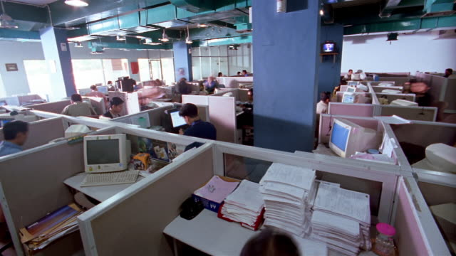 Time lapse high angle wide shot dolly shot busy office floor of call center / Jakarta, Indonesia