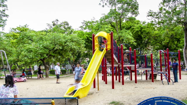 time lapse : kids playing at playground in the park