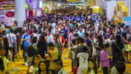 time lapse : large number of people travelling at indoor event