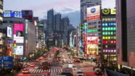 Time lapse long shot view along Koshu Kaido-dori Avenue towards Shinjuku Park Tower / Tokyo, Japan