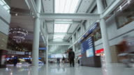 Time lapse low angle dolly shot luggage cart point of view through Incheon International Airport / South Korea
